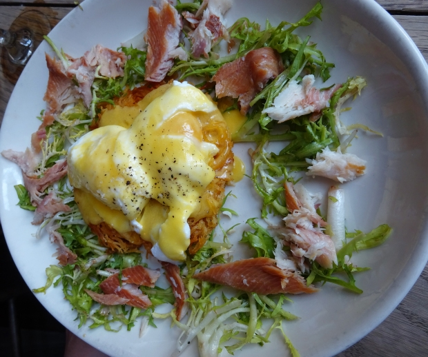 Potato Rosti, Smoked Trout & Eggs: rosti topped with smoked trout, two poached eggs, hollandaise sauce and frisee