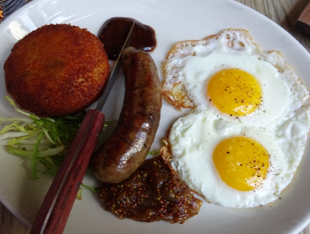 Bubble & Squeak: heritage pork sausage, 2 fried eggs, potato and cabbage croquettes, burnt onion mustard