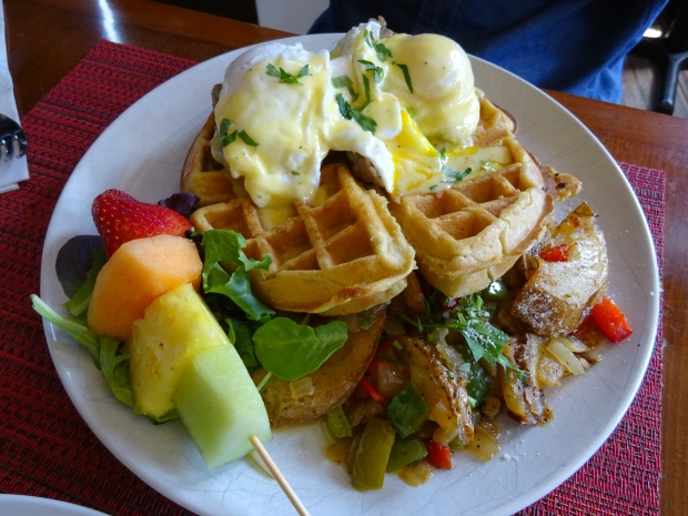 belgian benedict: 3 eggs poached over turkey sausage on a waffle topped with genuine maple syrup-hollandaise sauce & served with skillet potatoes